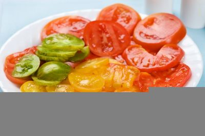 Plate of colorful fresh, juicy sliced Heirloom Tomatoes