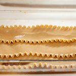Arrange three lasagna noodles,