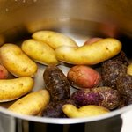 Cover the potatoes with salted cold water in a large pot.