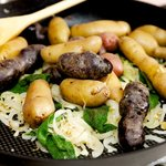 Add the boiled potatoes into the skillet.