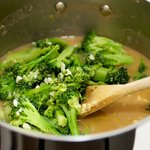 Add broccoli pieces to broth.