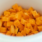 Add cubed sweet potatoes into crock pot.