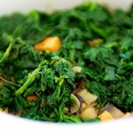 Stir the cooked spinach into crock pot.