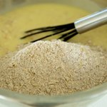 Add the flour mixture to the oats-egg mixture,