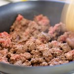 Brown beef and crumble in a large skillet.
