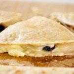 Cut each quesadilla into three wedges.