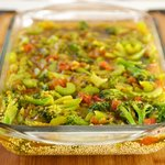 Pour into casserole dish with quinoa and broth.