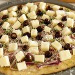 Place mozzarella cubes, black olives