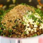 Add the garlic, lentils, cumin, coriander, cilantro and lemon juice.