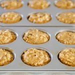 Pour into greased muffin tins,