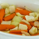 To drippings, stir in garlic, carrots and onion.