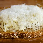 Next sprinkle parmesan cheese if using.