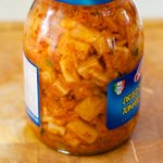Transfer the kimchi into a jar,