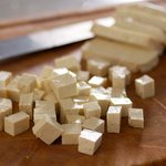 First let's cut the tofu into 1/2-inch cubes.