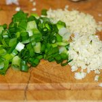 Meanwhile mince the garlic, ginger and slice the scallions.