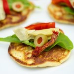 Fresh Corn Blinis with Roasted Bell Pepper, Artichoke Hearts and Arugula