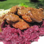 Jagerschnitzel with sweet and sour red cabbage and parsleyed potatoes