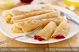 Raspberry Crepes with Creamy Orange Syrup