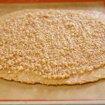 Spread the almond base evenly over the circle.