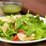 Arugula, Artichoke and Cherry Tomato  Salad with Pesto Vinaigrette