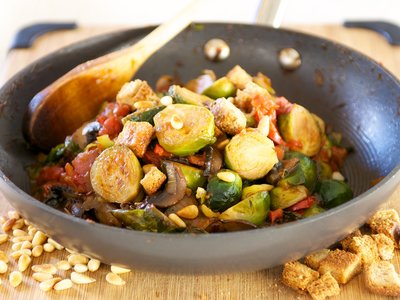 Tomato Braised Brussel Sprouts with Pine Nuts and Croutons