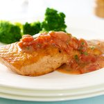 Fillet of Salmon with Anchovies and Tomatoes