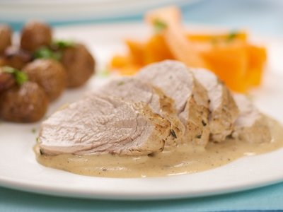 Pork Tenderloin Baked in White Wine, Cream Sauce, And Thyme