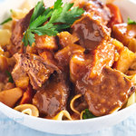 An easy crock pot beef stew recipe. This beef stew with tomato soup, potatoes, and carrots provides plenty of sauce. Perfect for serving with egg noodles, rice or crusty bread.