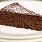 This flourless chocolate mocha cake is moist, rich and super chocolaty. You won't believe it's flour-less, so your gluten-free friends or family can all enjoy one or two slices of this decadent cake.