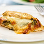 Stuffed chicken breast with spinach and cheese. One of our best baked chicken breast recipes. Stuffing is easy with the butterfly technique used in the recipe.