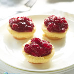 Mini cheesecakes with vanilla wafers, topped with cherry pie filling. Best of all they're so easy to make! Cheesy, smooth and delicious cheesecake that is made in your muffin pan.