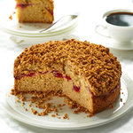 A sour cream coffee cake recipe with a ribbon of cherry pie filling topped with a delicious almond crumble.