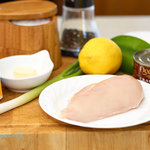 Ingredients for making chicken breasts Neptune assembled on a cutting board