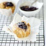 Quick and easy Bisquick muffins filled with fruit jam. Ready in a flash and contain no cholesterol.