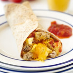 Easy breakfast tortilla recipe that's ready in 10 minutes for a grab n' go quick breakfast.