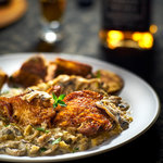 Golden brown chicken with loads of mushrooms, leeks and spiked with a whiskey cream sauce. 85