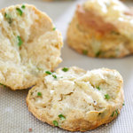 Turn garlic scapes into fluffy, cheesy buttermilk biscuits. The garlic scapes add a fresh mild hint of garlic to the savory biscuits which is perfectly complimentary.