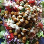 All of the flavor of a chickpea shawarma sandwich in a salad! Mediterranean-spiced chickpeas, fresh salad, and a 3-ingredient Garlic Dill dressing! A flavorful, filling, plant-based meal.