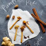 Raw ingredients for Pumpkin Pie Spice mix arranged on a black chalkboard background