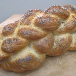 Double-braided, egg-enriched traditional bread, topped with poppy seeds.