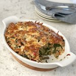 A great way to use up day old bread. A savory version of bread pudding with spinach and mushrooms that's cheesy delicious.