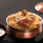 A flavourful and delicious combination of aromatic spices and juicy chicken with perfectly cooked rice, Hyderabadi Chicken Biryani is the stuff a biryani lover's dreams are made of. Considered to be a dish of the Nizams, Hyderabadi Chicken Biryani today has rightly acquired the title of the most popular biryani dish across the length and the breadth of the country.     A typical Hyderabadi Chicken Biryani is cooked in a variety of ways but two most famous and widely-practiced forms are:  Kachi biryani (where the meat or the chicken is marinated and mixed with the rice in raw form)  Pakki biryani (where chicken or meat is pre-cooked and then added to the rice)