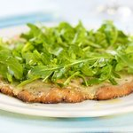 Cheesy and Garlicky White Pizza topped with Fresh Arugula