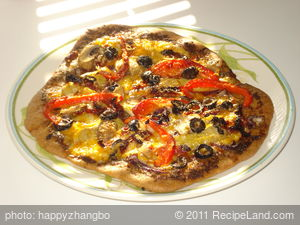 Basil Pesto, Artichoke Hearts, Sun-dried Tomato and Roasted Bell Pepper Pizza