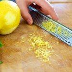 Freshly grate some lemon zest