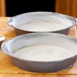 Flour the pans