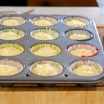 Divide batter evenly among prepared muffin cups