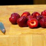 Wash the fresh strawberries, and hull them.