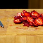 Slice the hulled strawberries.