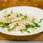 Mix 1/2 the cheese and cilantro with the shredded chicken